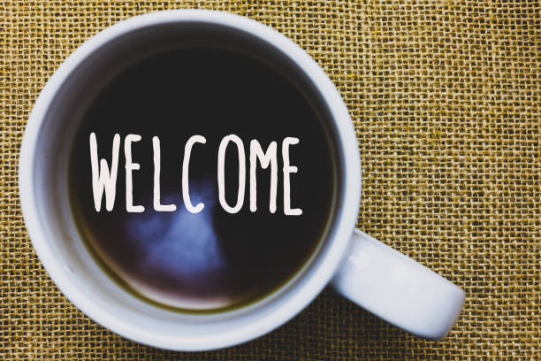 Handwriting text writing Welcome. Concept meaning Warm salutation acknowledgement for someone amiable loved thanked Mug coffee thoughts ideas creative inspirations nice mat black shadow. Handwriting text writing Welcome. Concept meaning Warm salutation acknowledgement for someone amiable loved thanked Mug coffee thoughts ideas creative inspirations nice mat black shadow aboard stock pictures, royalty-free photos & images