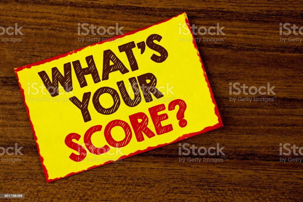 Handwriting text writing What Is Your Score Question. Concept meaning Tell Personal Individual Rating Average Results written on Yellow Sticky note paper on the wooden background. stock photo