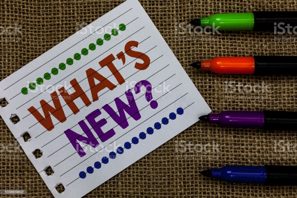 Handwriting text writing What s is New question. Concept meaning Asking about latest Updates Trends Happening News Notebook Paper Important reminder Communicate ideas Markers Jute background stock photo