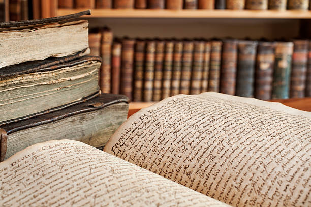 Handwritten antique book in a library stock photo