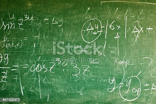 istock Handwritten equations on a green blackboard 847400372