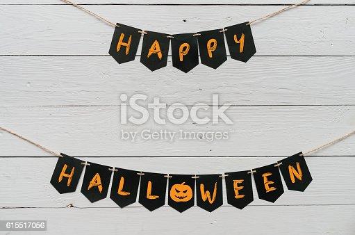 istock Handwritten happy halloween banner lettering 615517056
