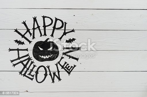 istock Handwritten happy halloween lettering, handdrawn cut pumpkin 615517324