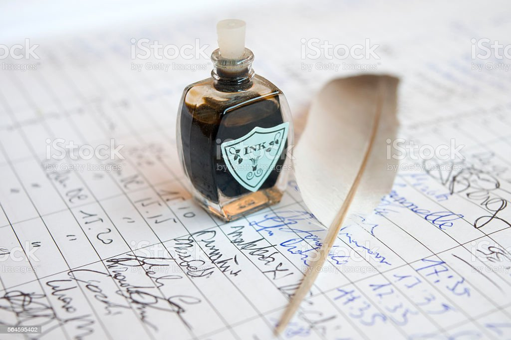 handwritten letter with plume and ink stock photo