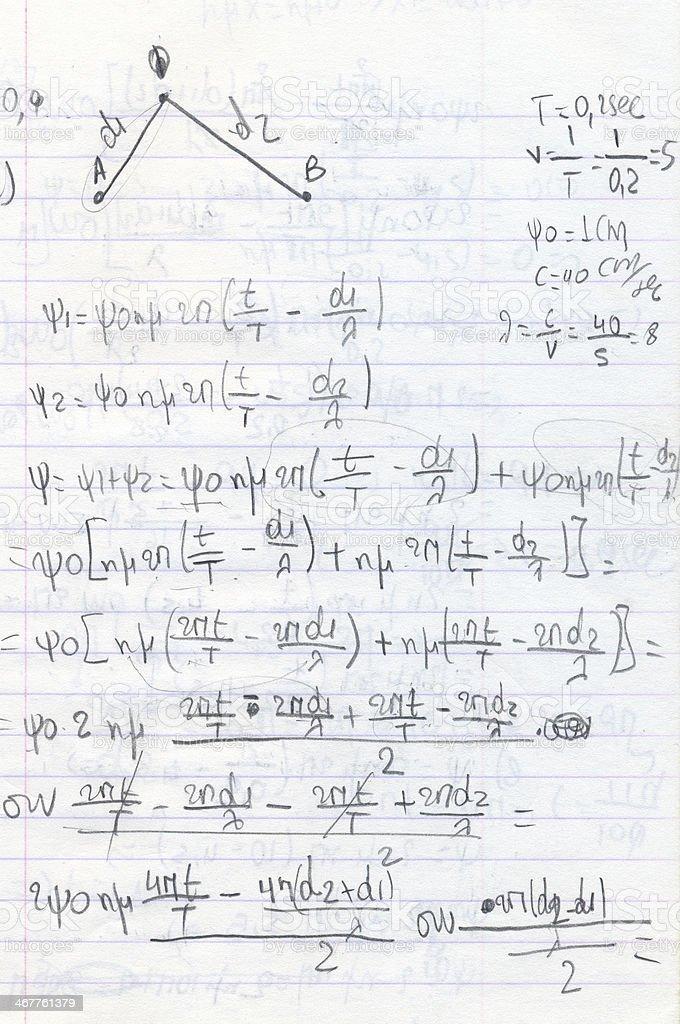 handwritten physics homework stock photo
