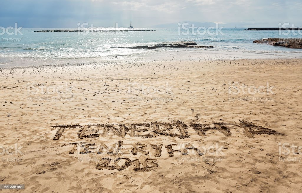 Handwritten sign on the sand - Torviscas Beach in Coasta Adeje, Tenerife - Canary Islands. stock photo