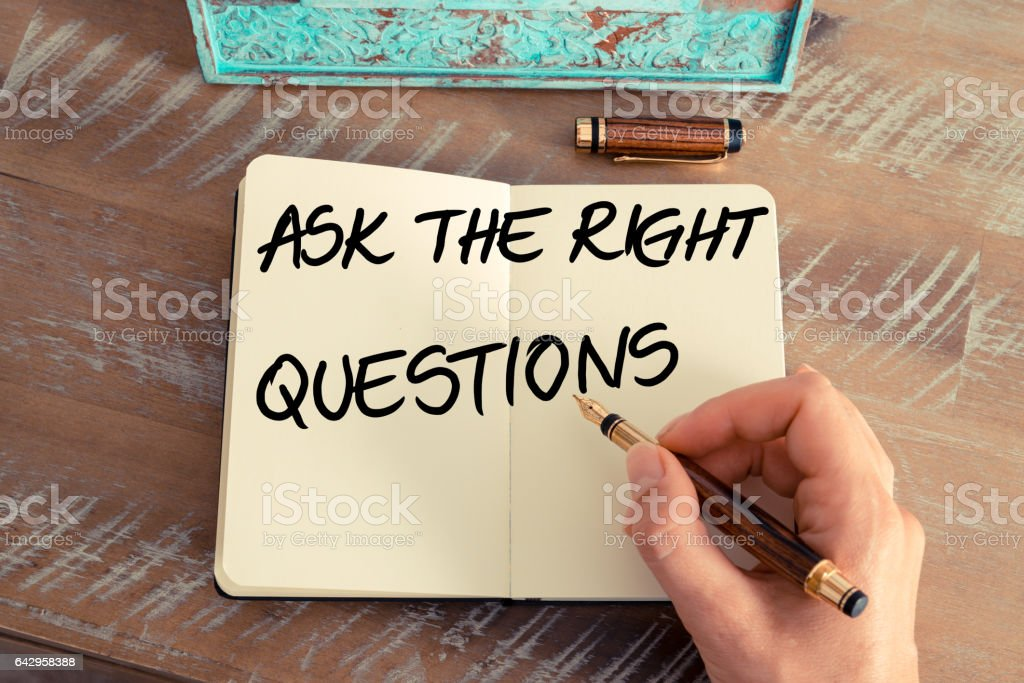 Handwritten text ASK THE RIGHT QUESTIONS stock photo