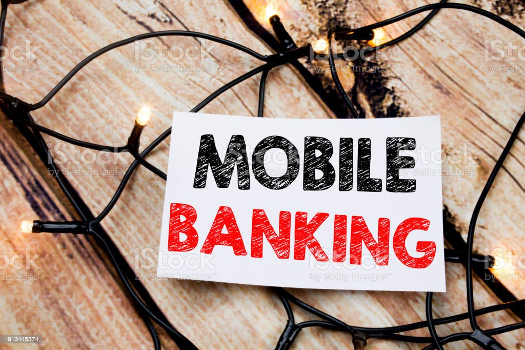 Handwritten text caption showing Mobile Banking. Business concept...