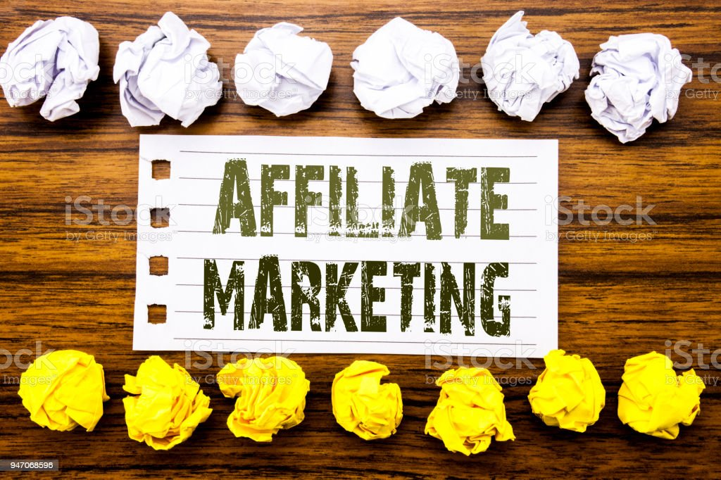 Handwritten text showing Affiliate Marketing. Business concept for Internet Online Written on sticky note, wooden with sticky, many folded paper white and yellow for difference or collaboration stock photo