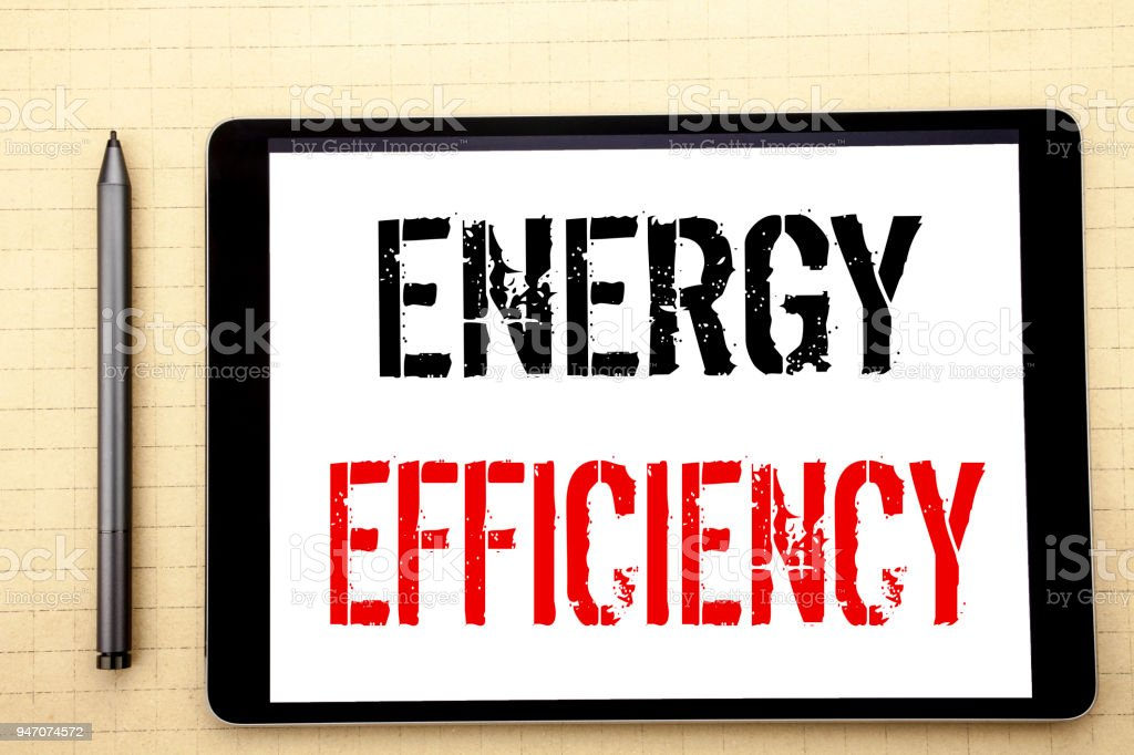 Handwritten text showing Energy Efficiency. Business concept writing for Electricity Ecology Written on tablet computer screen, white background in  office space view with pencil marker stock photo