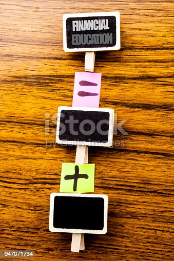 istock Handwritten text showing Financial Education. Business concept for Finance Knowledge Written on clips, wooden background for equation sign with plus. For your text. 947071734