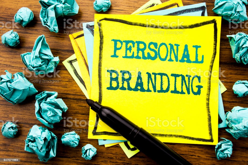 Handwritten text showing Personal Branding. Business concept for Brand Building Written on sticky note paper, wooden background with marker folded yellow paper meaning thinking – zdjęcie