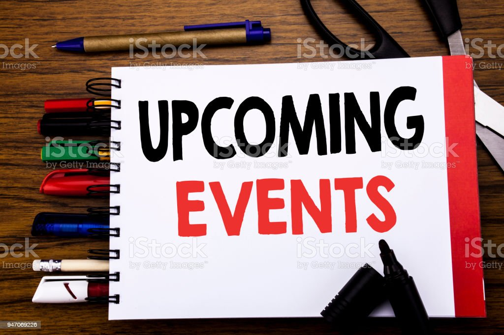Handwritten text showing Upcoming Events. Business concept for Appointment Agenda List Written on notebook, wooden background with office equipment like pens scissors colourful marker stock photo