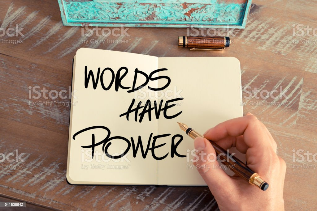 Handwritten text Words Have Power stock photo