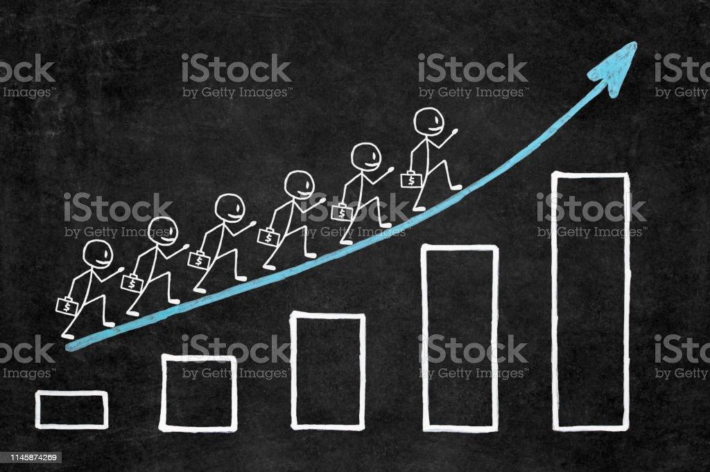 Handwritten white chalk growth graphic on blackboard. Six businessman...