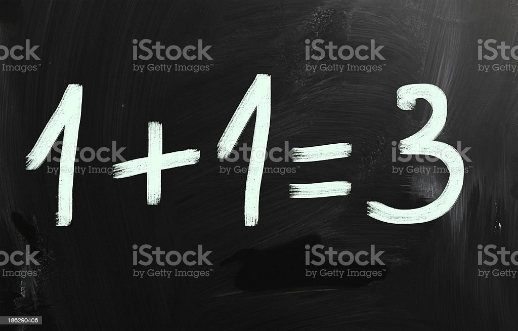 '1+1=3' handwritten with white chalk on a blackboard stock photo