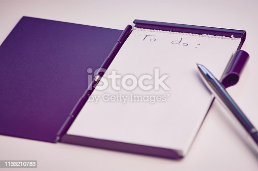 1090161334 istock photo handwritten words to do on a white pad 1133210783