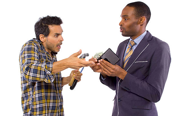 handy man getting paid by a businessman - disbursement stock pictures, royalty-free photos & images