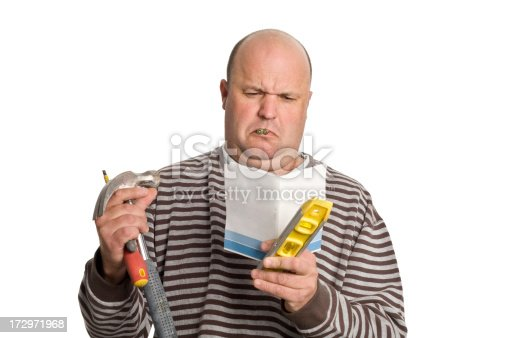 Man reading an instruction manual.