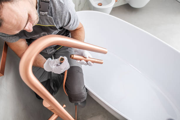 Handyman Attaches Faucet Kit To Complete Tub Installation. stock photo