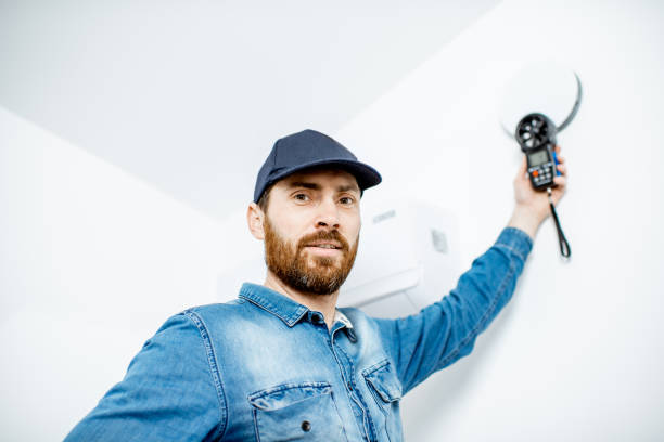 Handyman checking of air ventilation stock photo