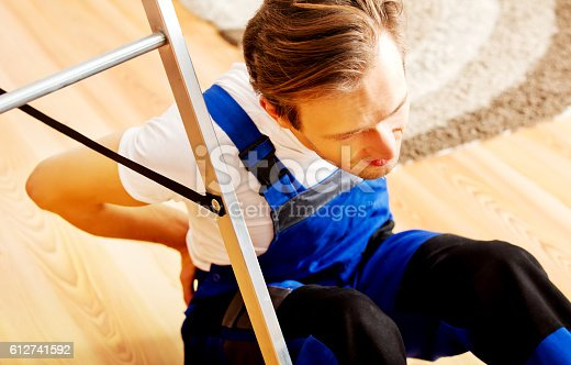 istock Handyman fell from a ladder 612741592