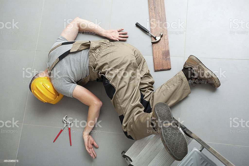 Handyman fell from ladder stock photo