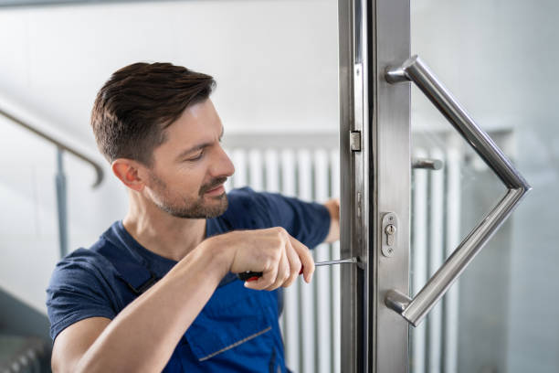 Handyman Fitting A New Door stock photo