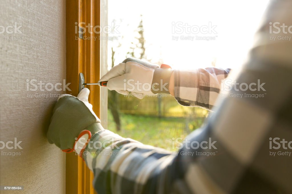 Handyman fixing the window with screwdriver foto stock royalty-free