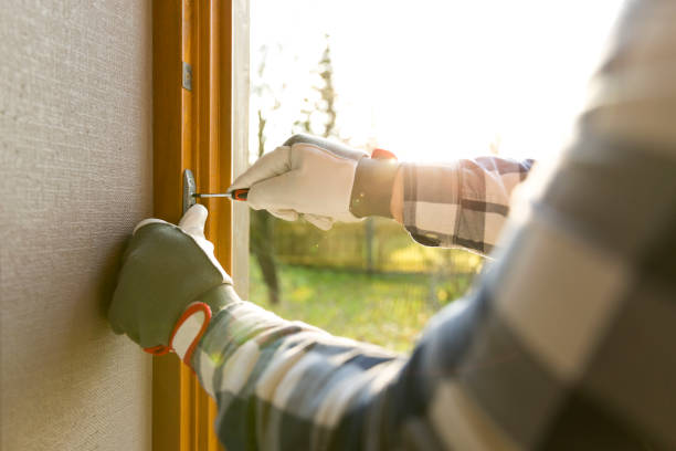 Handyman fixing the window with screwdriver stock photo