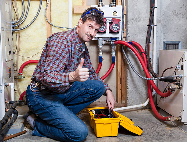 a handyman giving the thumbs up - furnace stock photos and pictures