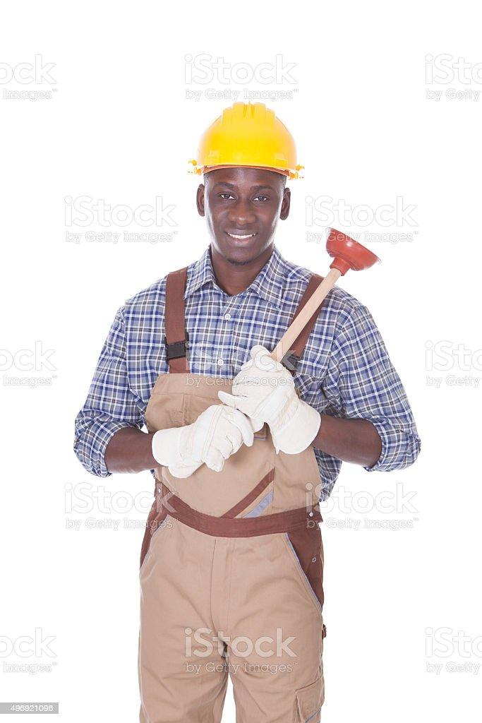 Handyman Holding Plunger stock photo