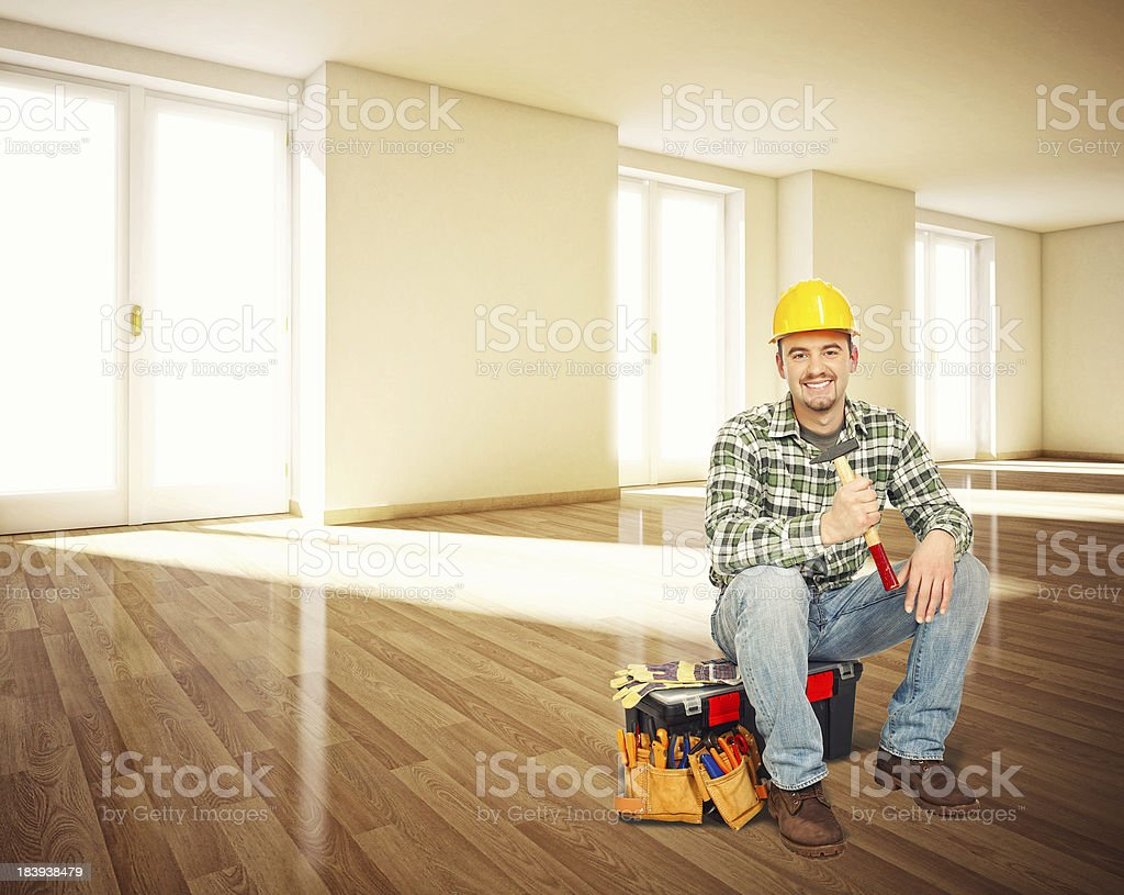 handyman in empty house royalty-free stock photo