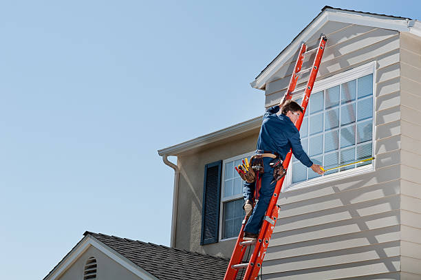 handyman in uniform measuring window - ladder stock photos and pictures