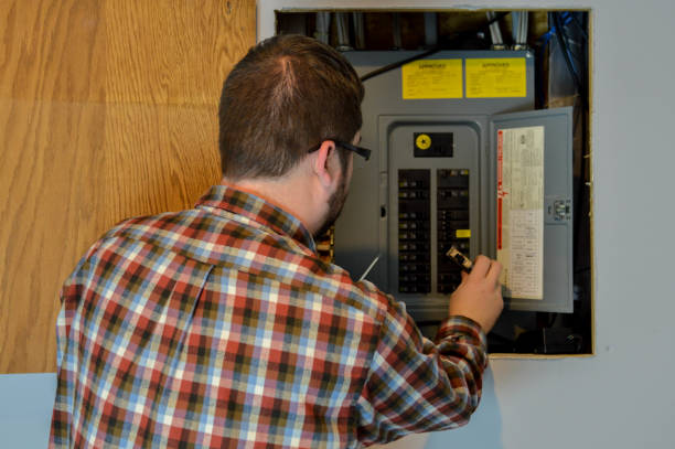 handyman inspecting an electric box - fuse box stock photos and pictures