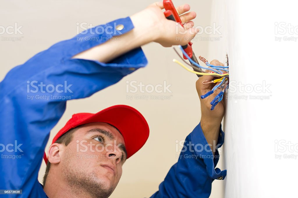 Handyman installing electricity royalty-free stock photo