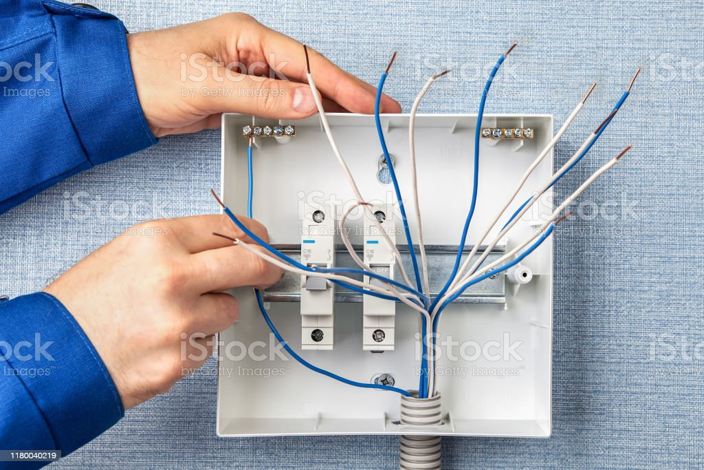 Handyman Installs Circuit Breakers For Home Wiring Stock Photo Download Image Now Istock