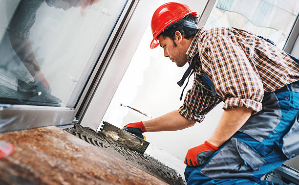 handyman laying ceramic tiles. - fliesenkleber stock-fotos und bilder