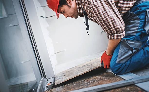 handyman laying ceramic tiles. - pflasterbau stock-fotos und bilder
