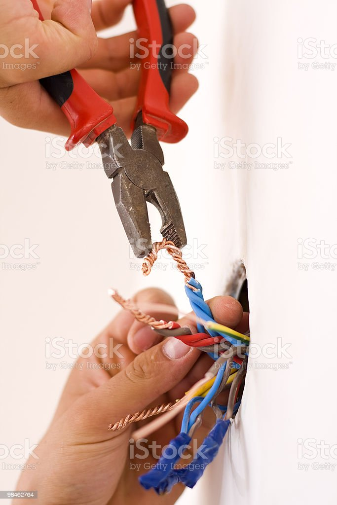 Handyman repairing colorful wiring royalty-free stock photo