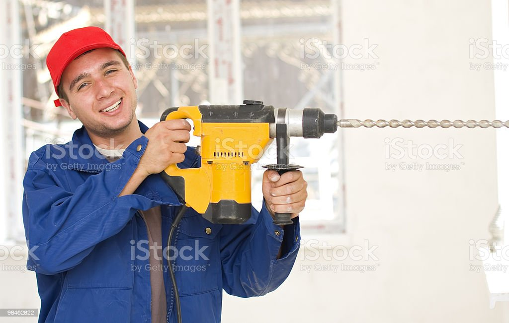 Handyman with a big drill royalty-free stock photo