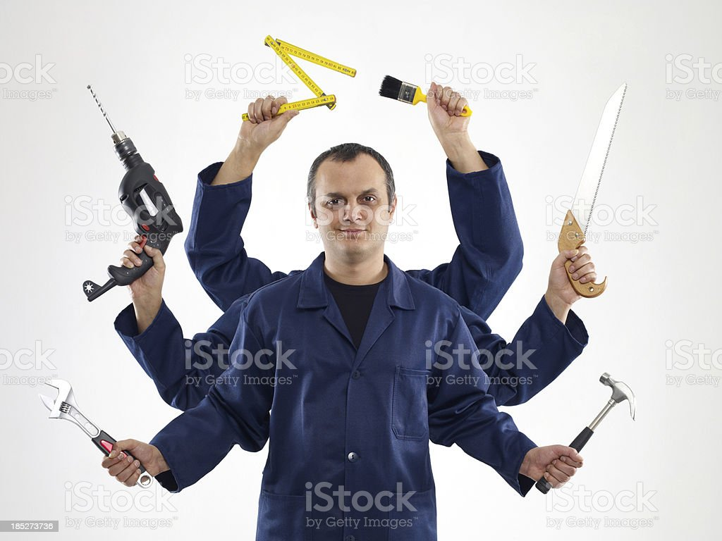 A handyman with six arms holding different tools stock photo