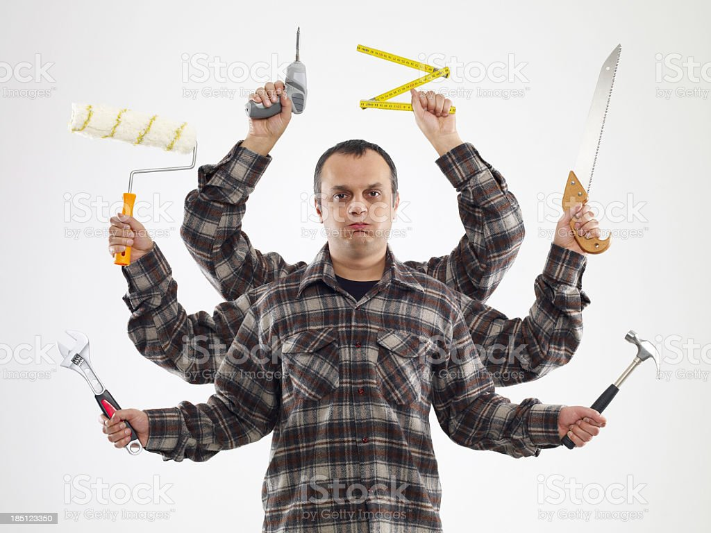 Handyman with six arms in flannel shirts holding tools stock photo