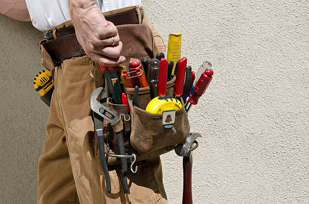 handyman with tool belt - tool belt stock photos and pictures