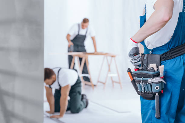 handyman with tool belt - renovation stock photos and pictures
