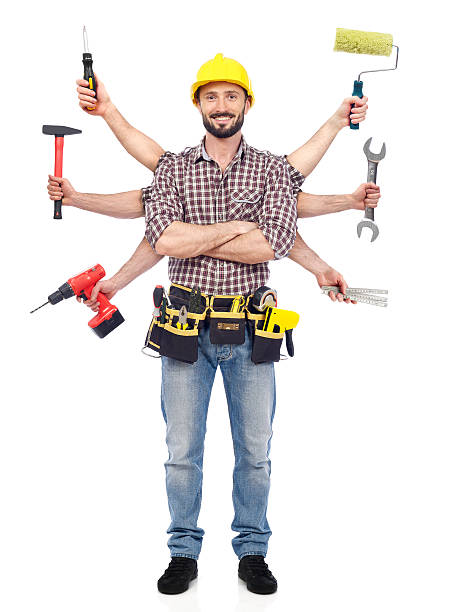 Handyman with tools stock photo