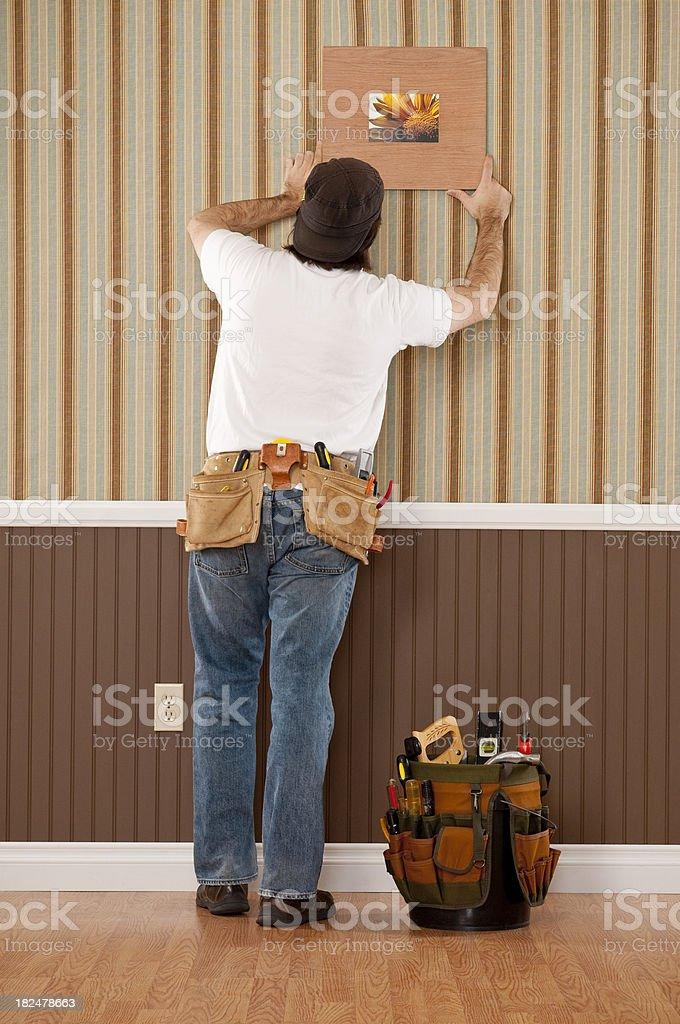 Handyman Working In Empty Room stock photo