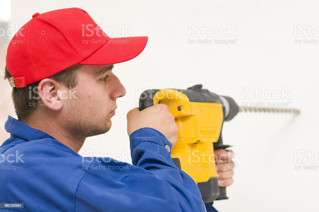 Handyman working with a big drill royalty-free stock photo