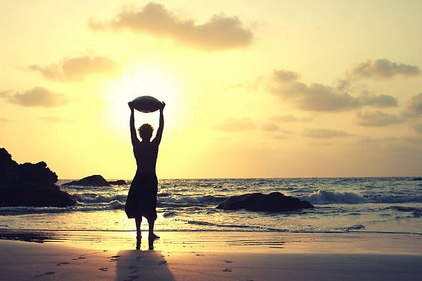 Hang drum misician on the sea shore on the sunset. stock photo