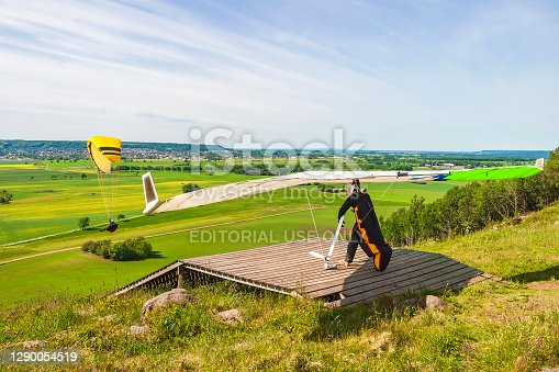 Falköping, Sweden - June 13, 2015: Hang glider at a ramp on a hill
